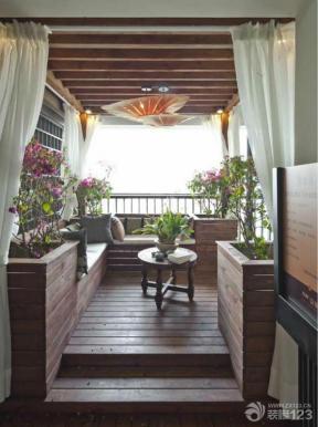 装饰品 墙面设计 木质墙面 木质茶几 圆形茶几 家庭休闲区 室内阳台
