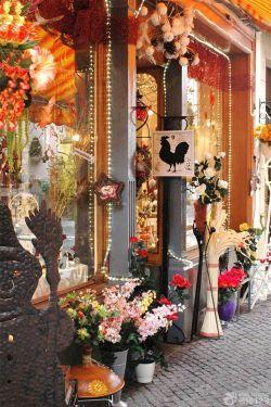创意花店门头铁艺花架设计图片