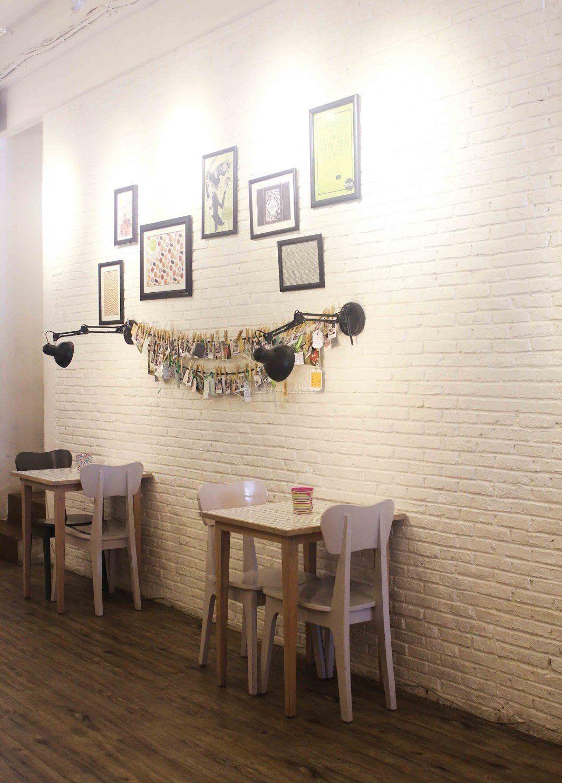 奶茶店装修照片墙效果图