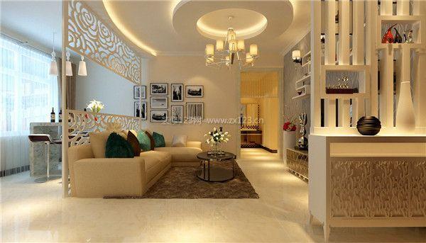 本设计方案中的客厅,设计师充分利用客厅空间,录用镂空雕花的木隔断